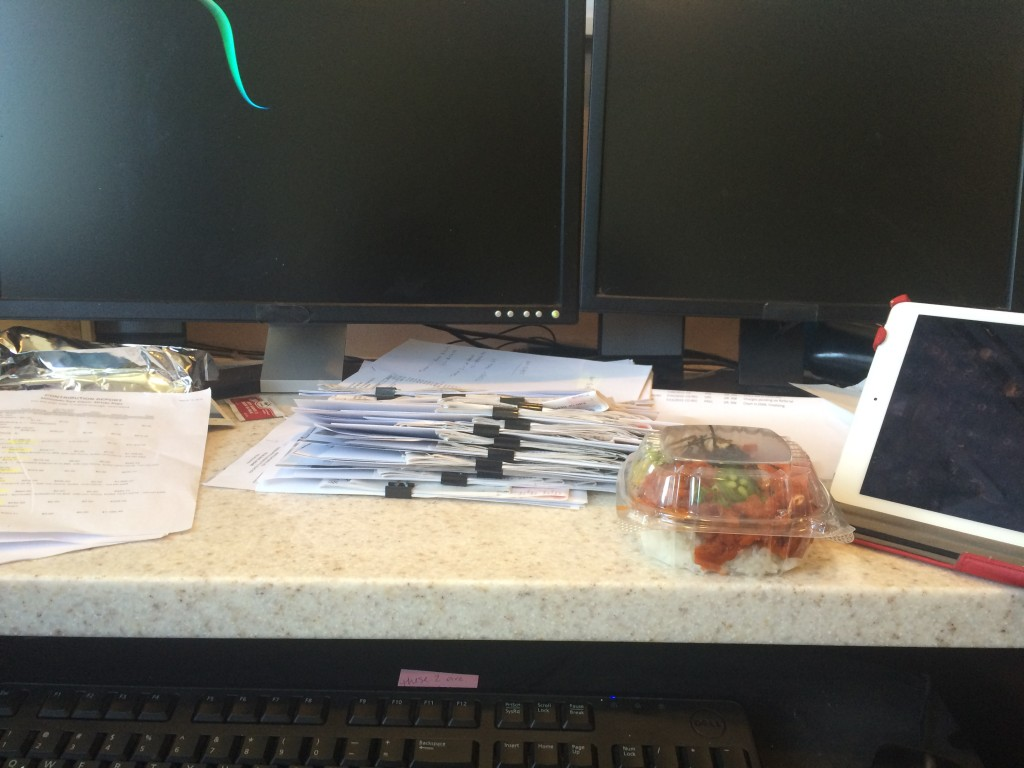 Yes, this is my desk - 2 monitors, an iPad and tons of bank statements.  With a spicy poke!
