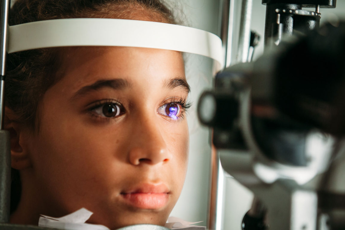 Girl getting eye exam
