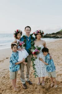 wong family on beach at wedding