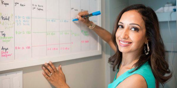 working mom using a family calendar